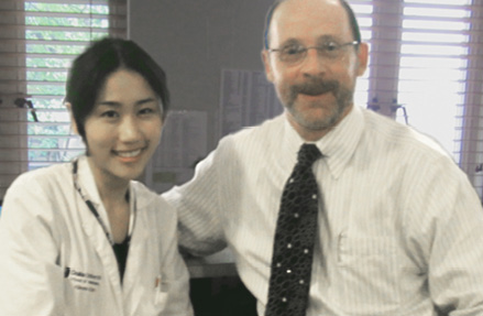 Aileen Kim, B.S., (left) with scientific advisor David M. Brizel, M.D.